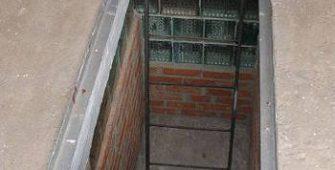 Смотровая яма в гараже из кирпича